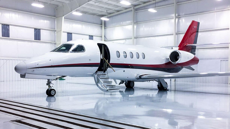 Cessna Citation Latitude in a bright clean hangar.
