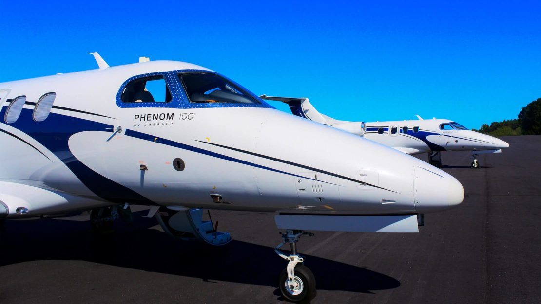 Two Phenom 100s on a runway
