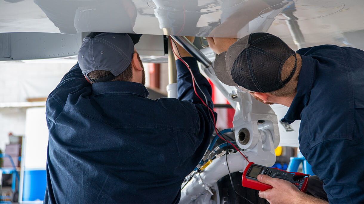 Corr Aviation Techs Inspecting An Aircraft Engine